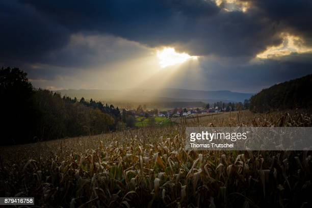 A ray of light breaks through dark clouds and illuminates the village of Heyda on November 02 2017 in Heyda Germany