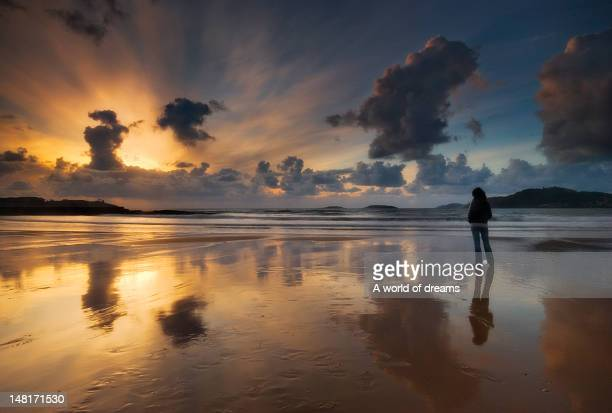 ray of light in playa américa beach in pontevedra - pontevedra province stock photos and pictures