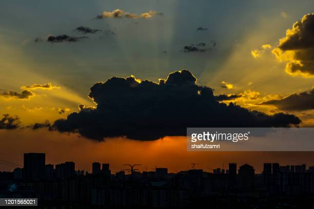ray of light over downtown kuala lumpur - shaifulzamri stock pictures, royalty-free photos & images