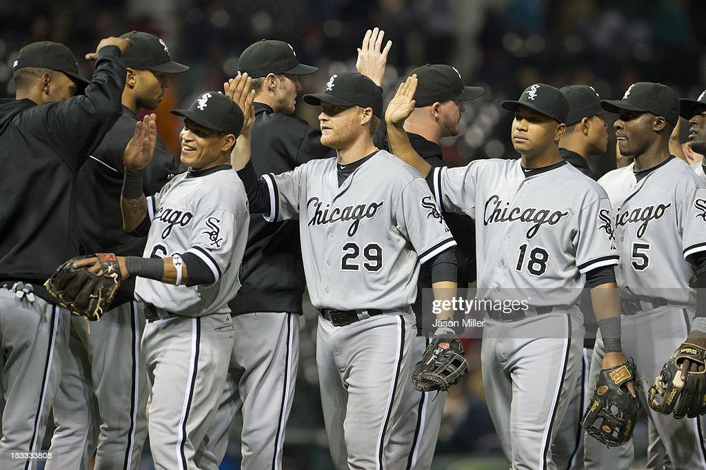 Ray Olmedo #66 Dan Johnson #29 Jose Lopez #18 and Orlando Hudson #5 of the Chicago White Sox celebrate after the White Sox defeated the Cleveland Indians at Progressive Field on October 3, 2012 in Cleveland, Ohio. The White Sox defeated the Indians 9-0.