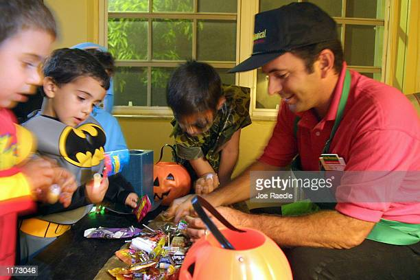 Ray Orozco inspects candy October 31 2001 picked up by his children and other trick or treaters Halloween night in Miami Florida
