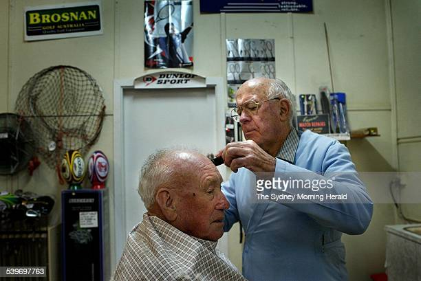 Ray Orr gives a trim to his friend Matt Faff at his Lake Cargelligo store 16 June 2005 SMH Picture by KATE GERAGHTY