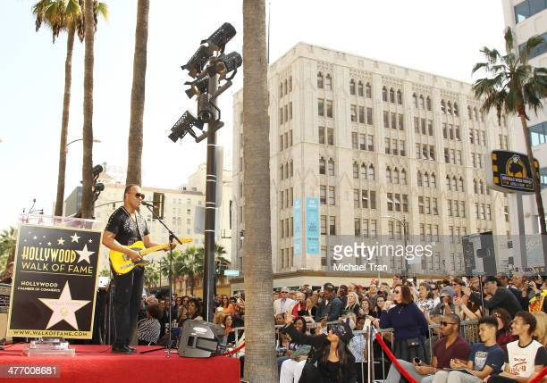 Ray Parker Jr. Performs at the ceremony honoring him with a Star on The Hollywood Walk of Fame on March 6, 2014 in Hollywood, California.