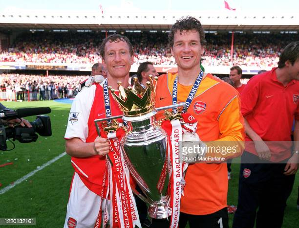Ray Parlour and Jens Lehmann of Arsenal with the Premier League trophy after the Premier League match between Arsenal and Leicester City on May 15,...
