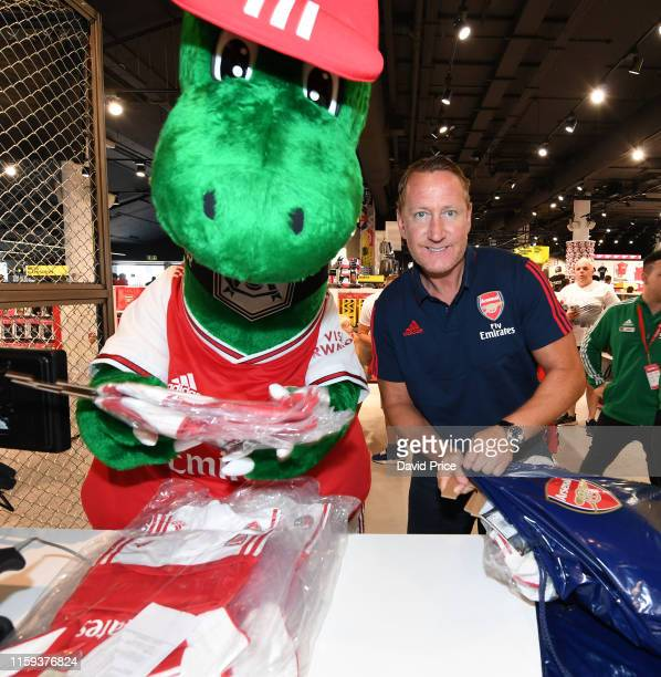 Ray Parlour helps Gunnersaurus pack kits for children at a local hospital during the Arsenal 2019-20 home kit is launch at the Armoury Shop at...