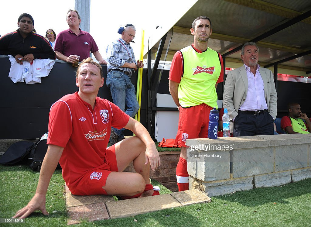Ray Parlour, Martin Keown, and Terry Venables, technical advisor of Wembley FC, look on from the bench during a Budweiser FA Cup Extra Preliminary Round at Vale Farm Stadium, on August 11, 2012 in Wembley, London, England.