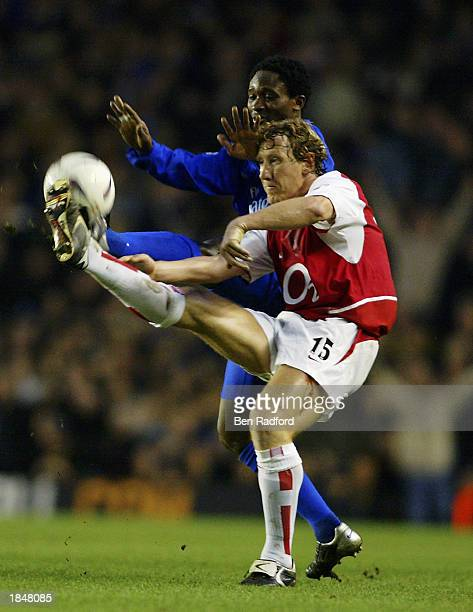 Ray Parlour of Arsenal reaches the ball ahead of Celestine Babayaro of Chelsea during the FA Cup QuarterFinal match held on March 8 2003 at Highbury...