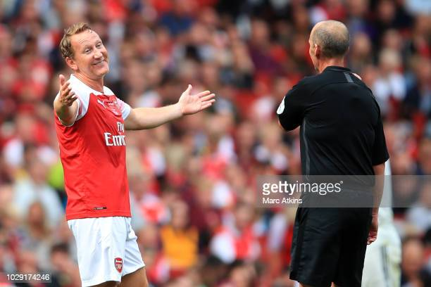 Ray Parlour of Arsenal reacts toward Referee Mike Dean during the match between Arsenal Legends and Real Madrid Legends at Emirates Stadium on...