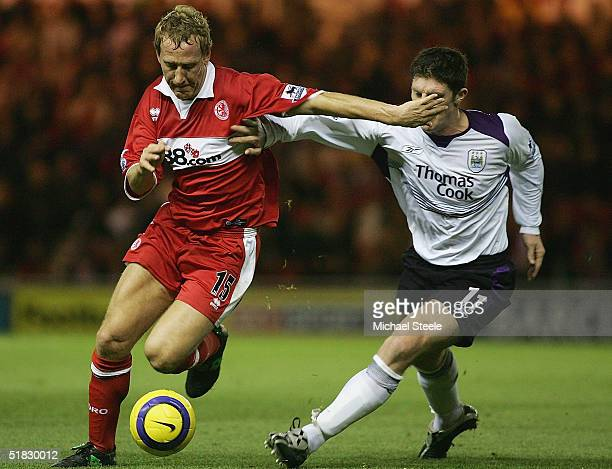 Ray Parlour of Middlesbrough holds off Jon Macken of Manchester City during the Barclays Premiership match between Middlesbrough and Manchester City...