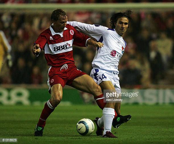 Ray Parlour of Middlesbrough tackles Michal Papadopulos of Banik Ostrava during the UEFA Cup first round, first leg match between Middlesbrough and...