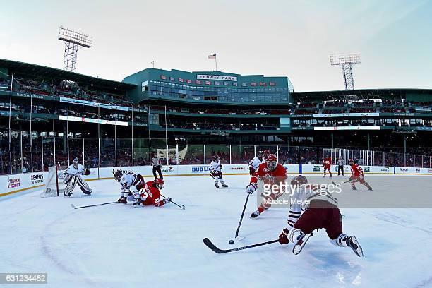 Ray Pigozzi of The Massachusetts Minutemen defends Brandon Hickey of the Boston University Terriers at Fenway Park on January 8, 2017 in Boston,...