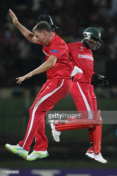 Ray Price celebrates bowling Shahid Afridi with Tatenda Taibu during the Pakistan v Zimbabwe 2011 ICC World Cup Group A match at the Pallekele...
