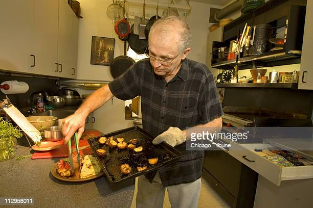 Ray Reiss owner of Ray's Bucktown Bed and Breakfast cooks a roasted red potatoes breakfast for some of his staff members in Chicago Illinois