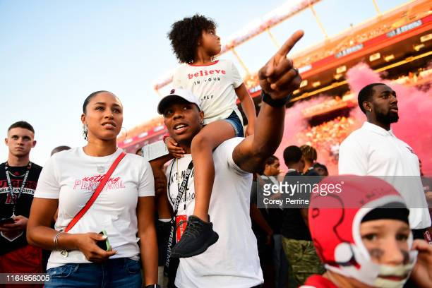 Ray Rice a former American football running back with the Baltimore Ravens, talks with his wife Janay Palmer while holding his daughter Rayven,...