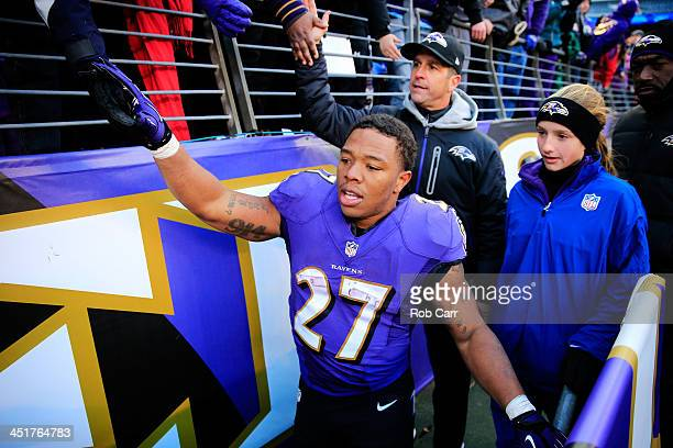 Ray Rice and head coach John Harbaugh of the Baltimore Ravens walk off the field with his daughter Alison following the Ravens 193 win over the New...