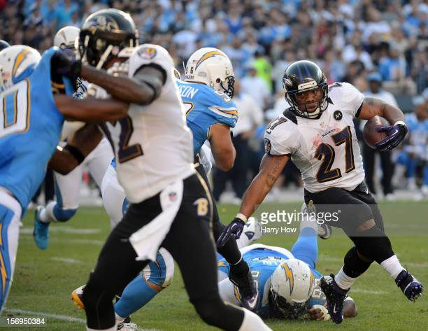 Ray Rice of the Baltimore Ravens avoids a tackle as comes out of the backfield during a 16-13 Raven win over the San Diego Chargers in overtime at...