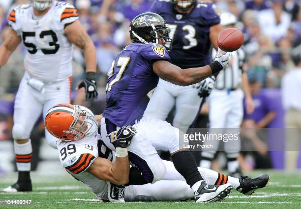 Ray Rice of the Baltimore Ravens can't hold onto a pass as he's taken down by Scott Fujita of the Cleveland Browns at M&T Bank Stadium on September...