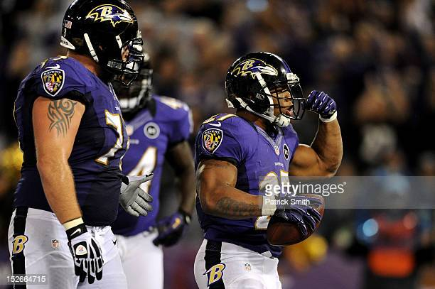 Ray Rice of the Baltimore Ravens celebrates after he scored a 7-yard rushing touchdown in the third quarter against the New England Patriots at M&T...