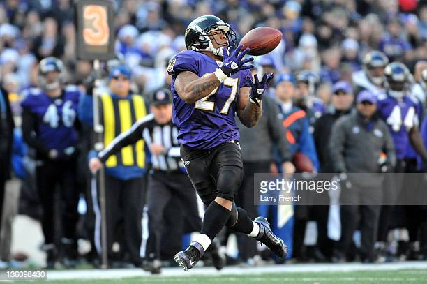 Ray Rice of the Baltimore Ravens hauls in a pass for a touchdown against the Cleveland Browns at MT Bank Stadium on December 24 2011 in Baltimore...