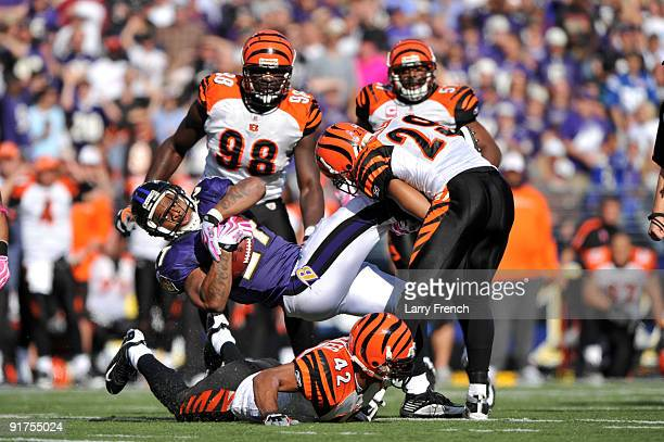 Ray Rice of the Baltimore Ravens makes a catch and gets tackled by the Cincinnati Bengals at M&T Bank Stadium on October 11, 2009 in Baltimore,...
