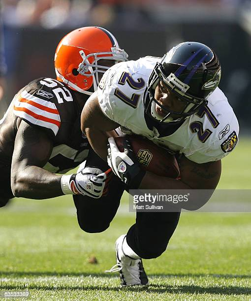 Ray Rice of the Baltimore Ravens runs the ball as he is hit by D'Qwell Jackson of the Cleveland Browns during the second quarter of their NFL game at...