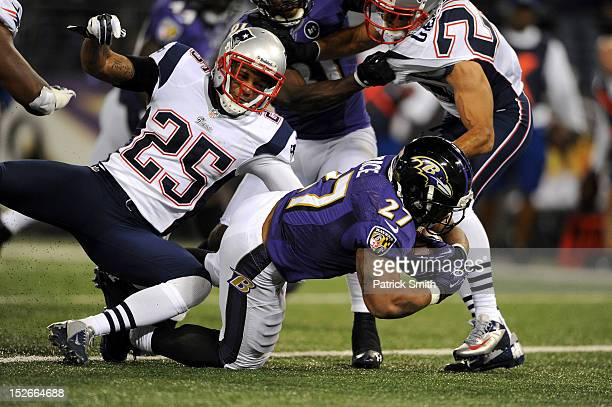 Ray Rice of the Baltimore Ravens scores a 7-yard rushing touchdown in the third quarter against the New England Patriots at M&T Bank Stadium on...