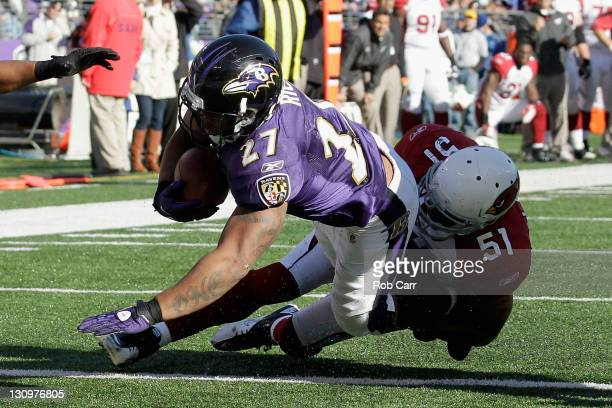 Ray Rice of the Baltimore Ravens scores a second half touchdown while being tackled by Paris Lenon of the Arizona Cardinals at M&T Bank Stadium on...