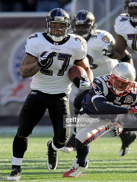 Ray Rice of the Baltimore Ravens takes the first play from scrimmage for a touchdown against the New England Patriots in their AFC Wild Card playoff...