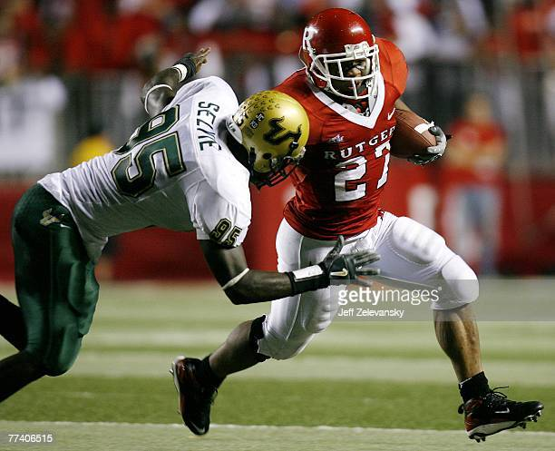 Ray Rice of the Rutgers Scarlet Knights tries to get by DE George Selvie of the South Florida Bulls in the first half of a game at Rutgers Stadium...