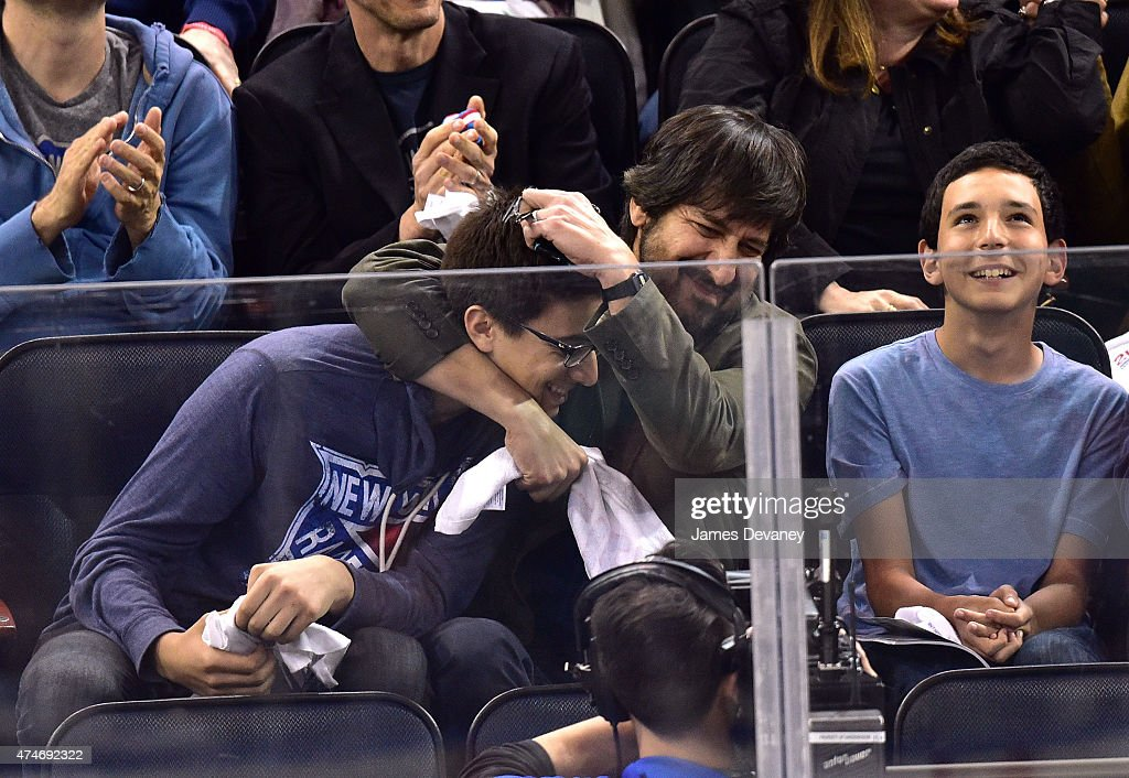 Ray Romano and guest (L) attend the Tampa Bay Lightning vs New York Rangers playoff game at Madison Square Garden on May 24, 2015 in New York City.