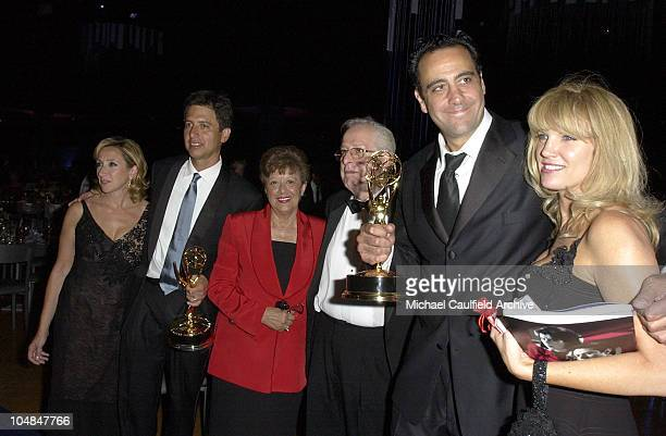 Ray Romano his wife and parents and Brad Garrett with his wife Jill Diven holding their Emmys at the Governors' Ball