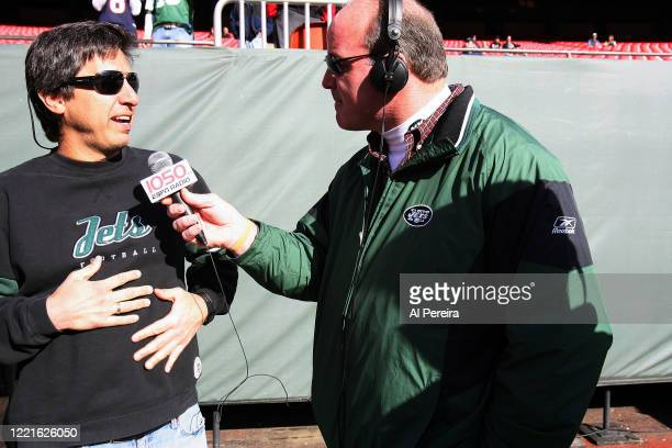 Ray Romano speaks with New York Jets radio personality and alumni player Marty Lyons when he attends the New York Jets vs Houston Texans game at the...