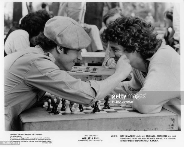 Ray Sharkey and Michael Ontkean talk over a game of chess in a scene from the 20th Century Fox movie Willie Phil circa 1980