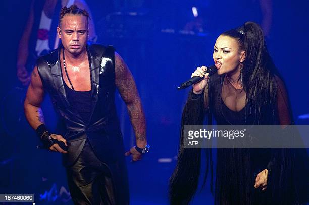 Ray Slijngaard and Anita Doth of 2 Unlimited perform with a live band in Amsterdam's Melkweg The Netherlands during the MTV Music Week AFP PHOTO /...