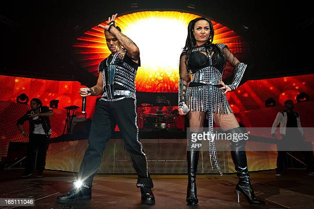 Ray Slijngaard and Anita Doth of Dutch band 2 Unlimited perform on stage at the Sportpaleis Arena in Antwerp on March 30 2013 AFP PHOTO / BELGA /...