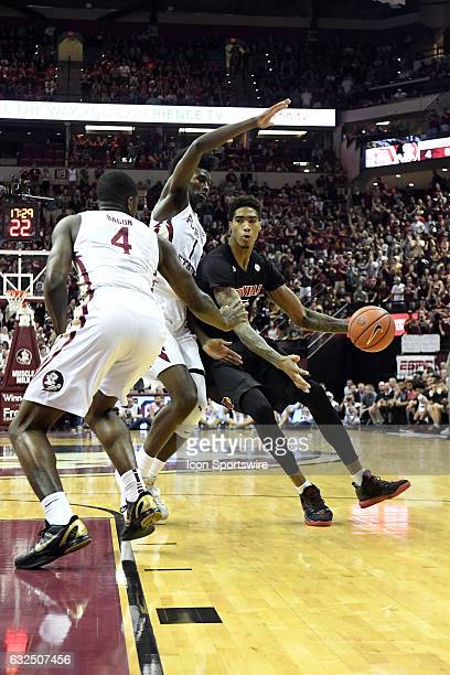 Ray Spalding forward Louisville Cardinals works against Jonathan Isaac forward and Dwayne Bacon guard Florida State University Seminoles in an...