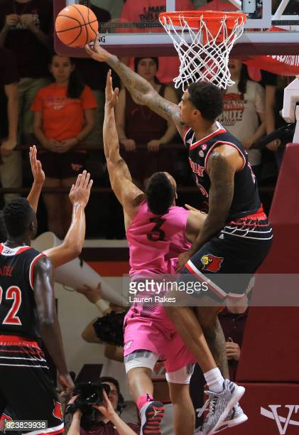 Ray Spalding of the Louisville Cardinals blocks an attempted shot by Justin Robinson of the Virginia Tech Hokies in the first half at Cassell...