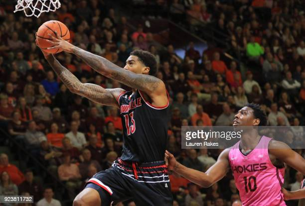 Ray Spalding of the Louisville Cardinals shoots against Justin Bibbs of the Virginia Tech Hokies in the first half at Cassell Coliseum on February 24...