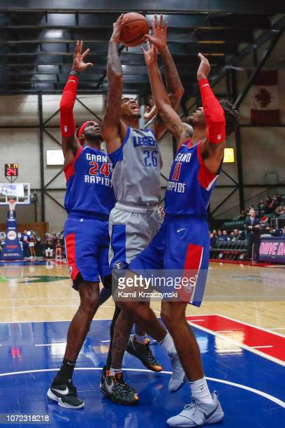 Ray Spalding of the Texas Legends is defended by Johnny Hamilton and Todd Withers of the Grand Rapids Drive on December 12 2018 at DeltaPlex Arena in...