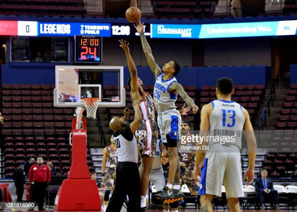 Ray Spalding of the Texas Legends reaches for the ball at tip off at Landers Center in an NBA GLeague game against the Memphis Hustleon January 12...