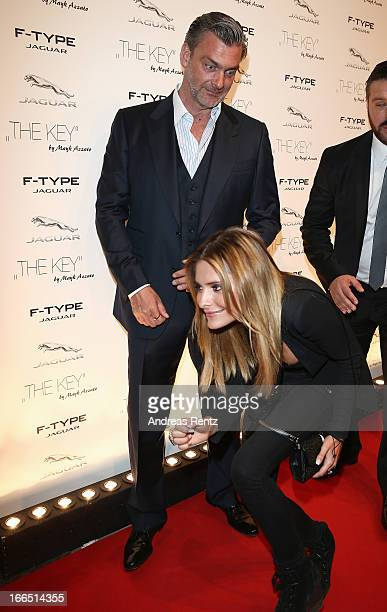 Ray Stevenson reacts as Sophia Thomalla passes him upon her arrivat at the Jaguar FType short film 'The Key' Premiere at eWerk on April 13 2013 in...