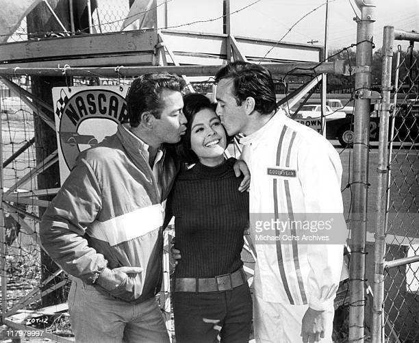 Ray Stricklyn and Tommy Kirk kiss Brenda Benet in a scene from the film 'Track of Thunder' 1967