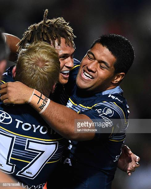 Ray Thompson of the Cowboys celebrates after scoring a try with Ben Hannant and John Asiata of the Cowboys during the round 13 NRL match between the...