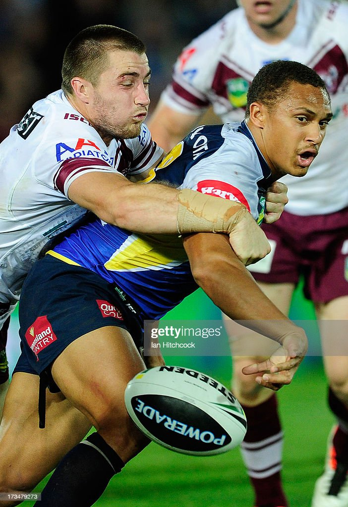 Ray Thompson of the Cowboys drops the ball after being tackled by Kieran Foran of the Sea Eagles during the round 18 NRL match between the North Queensland Cowboys and the Manly Sea Eagles at 1300SMILES Stadium on July 15, 2013 in Townsville, Australia.