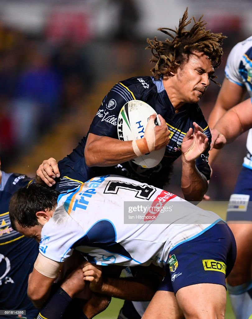 Ray Thompson of the Cowboys is tackled by Tyrone Roberts of the Titans during the round 13 NRL match between the North Queensland Cowboys and the Gold Coast Titans at 1300SMILES Stadium on June 3, 2017 in Townsville, Australia.