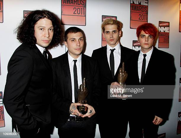 Ray Toro Frank Iero Mikey Way and Gerard Way of My Chemical Romance pose against the Shockwaves NME Awards 2011 winners boards with their award for...