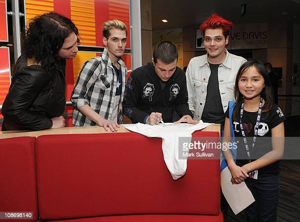 Ray Toro Mikey Way Frank Iero and Gerard Way of My Chemical Romance pose with a fan after American Express Presents My Chemical Romance at The GRAMMY...