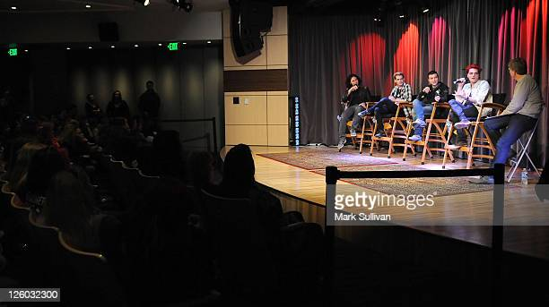 Ray Toro Mikey Way Frank Iero and Gerard Way of My Chemical Romance speak with GRAMMY Museum executive director Robert Santelli during American...