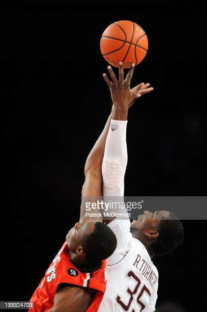Ray Turner of the Texas AM Aggies and God'sgift Achiuwa of the St John's Red Storm battle for the ball during the 2K Sports Classic Benefiting...