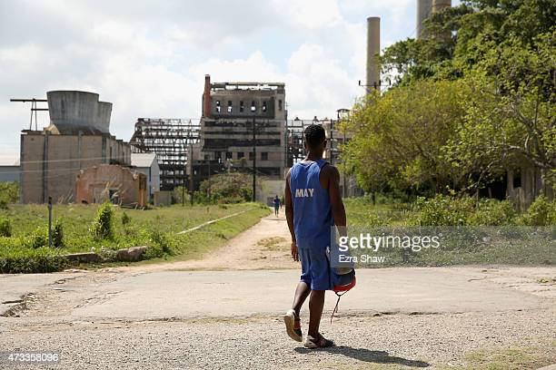 Ray Uamlet Quijano Font walks to the boxing ring at the Mayabeque Boxing Academy with the old Hershey sugar factory in the background on May 12 2015...